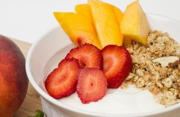 Image shows a bowl of yogurt and fruit.