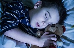 Image shows a sleeping child.