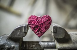 Image shows a heart in a vice.