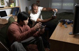 Image shows people playing video games.