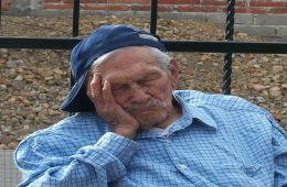 Image shows an old man taking a nap.