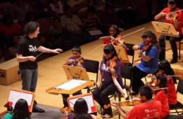 Image shows a children's orchestra.