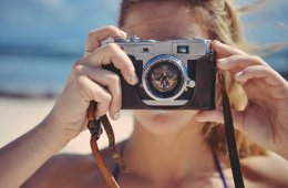 Image shows a woman taking a photo.