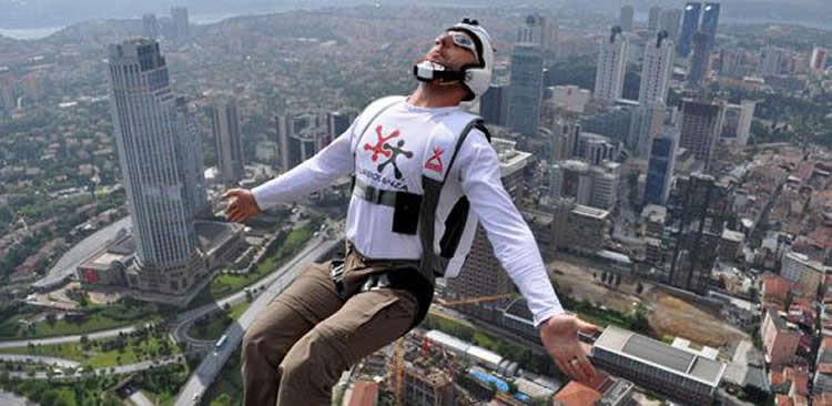 Image shows a base jumper.