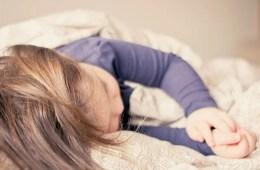 Image shows a sleepy little girl.