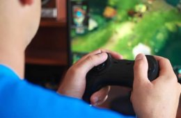 Image shows a person playing video games.