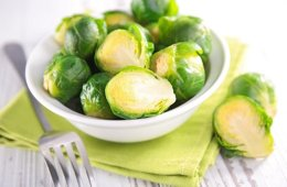 Image shows a bowl of brussle sprouts.