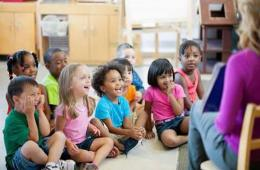 Image shows children in a classroom.