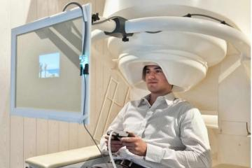 mage shows a person in an MEG machine.