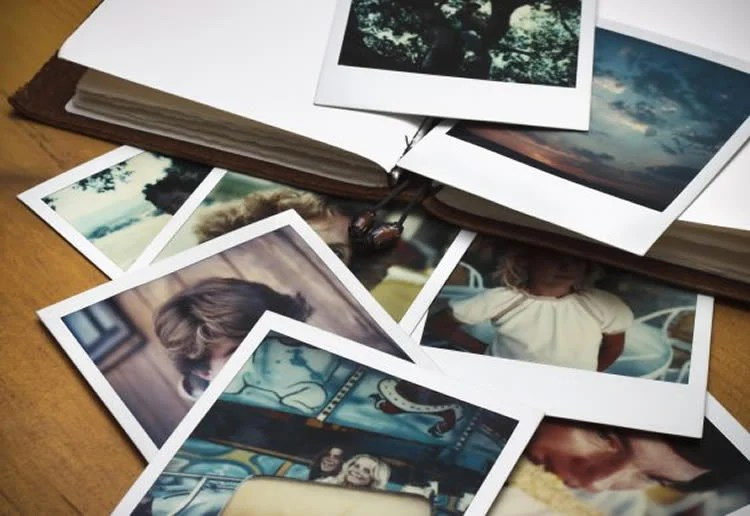 Image shows a collection of old photos.