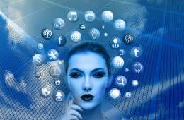 Image shows a woman surrounded by social media icons.
