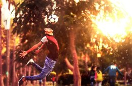 Image shows a person heading a soccer ball.