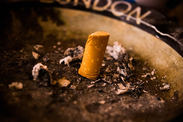 Image shows a stubbed out cigarette.