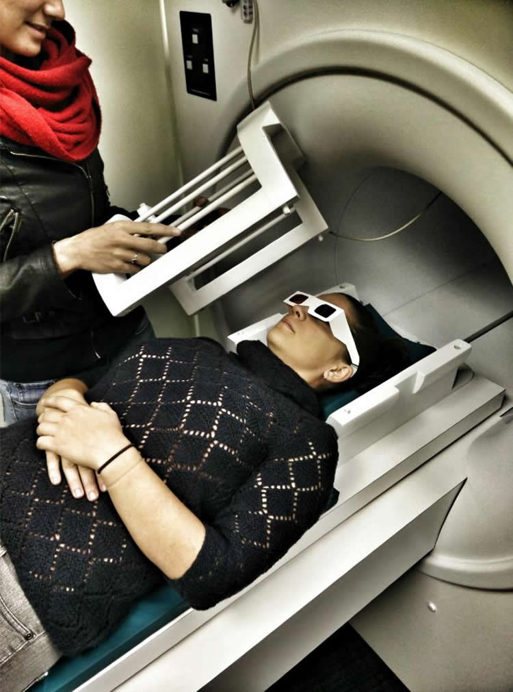 Image shows the researcher in a fMRI scanner.