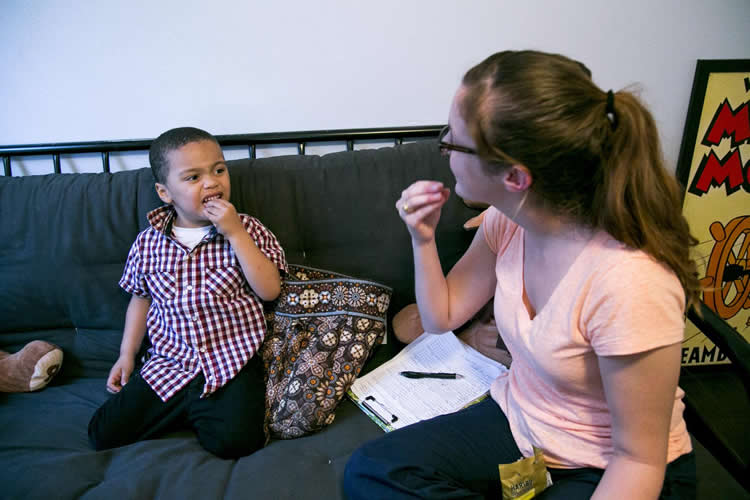 Image shows the researcher and a young boy.