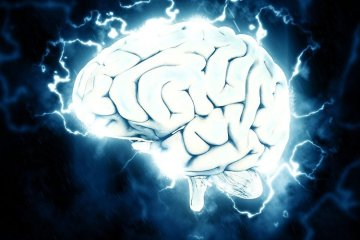Image shows a brain and electricity.