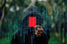 Image shows a person and computer code.