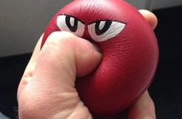Image shows a person squeezing a stress ball.