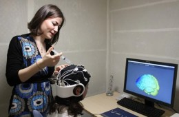 Image shows a researcher with a test subject.
