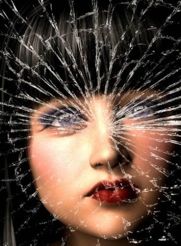 Image shows a woman and shattered glass.