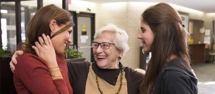 Image shows a granny and her granddaughters.