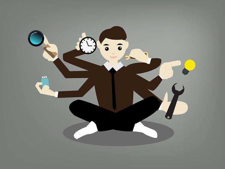 Image shows a cartoon of a person multitasking.