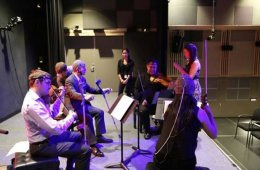 Image shows a group of musicians practicing.