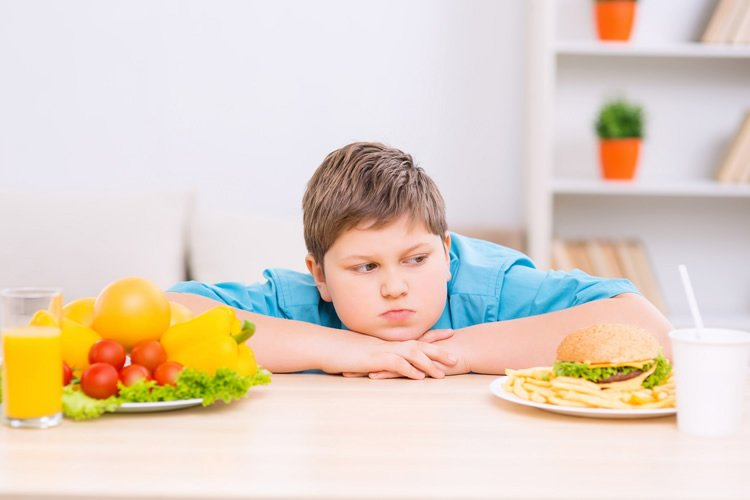 Image shows a boy and food.