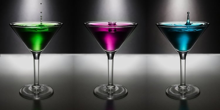 Image shows 3 colored drinks.
