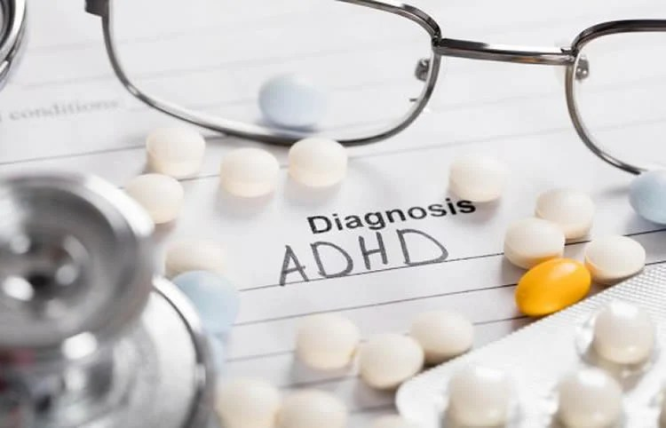"Image shows a pills and paper with ""Diagnosis: ADHD"" written on it."