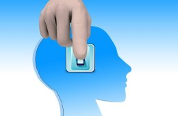Image shows a person pushing a switch on a head.
