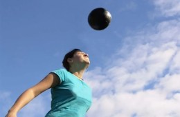 a woman playing soccer