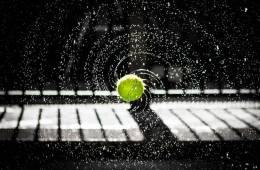 Image shows a tennis ball bouncing.