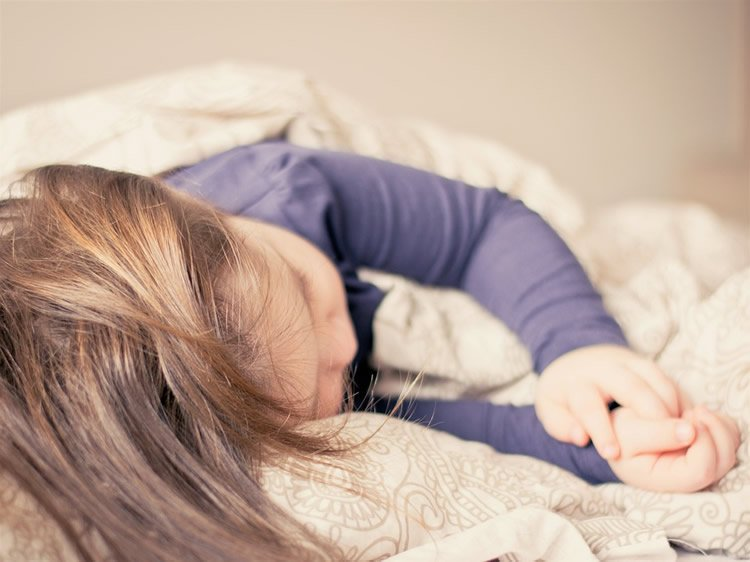 Image shows a girl sleeping.