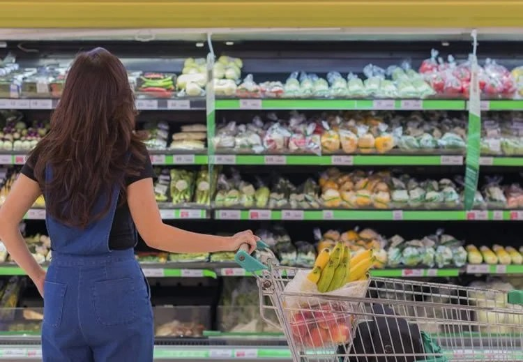 Image shows a woman shopping.