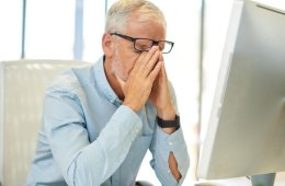 Image shows a person rubbing their eyes.