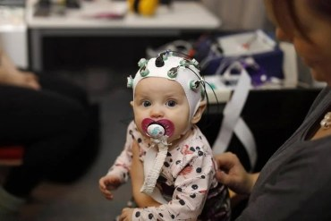 a baby in an eeg cap