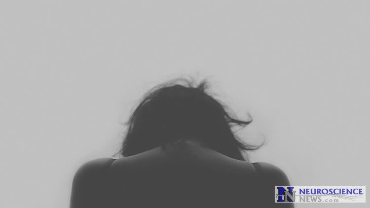 Image shows a depressed woman.