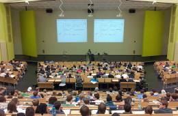 Image shows a lecture hall.