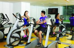 Image shows people on exercise bikes.
