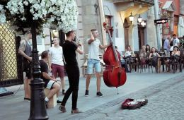 Image shows street musicians.