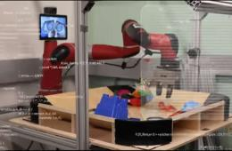 Image shows the robotic arm sorting through toys.