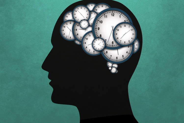 Image shows a head made up of clocks.