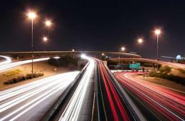 Image shows blurred car lights on a road.