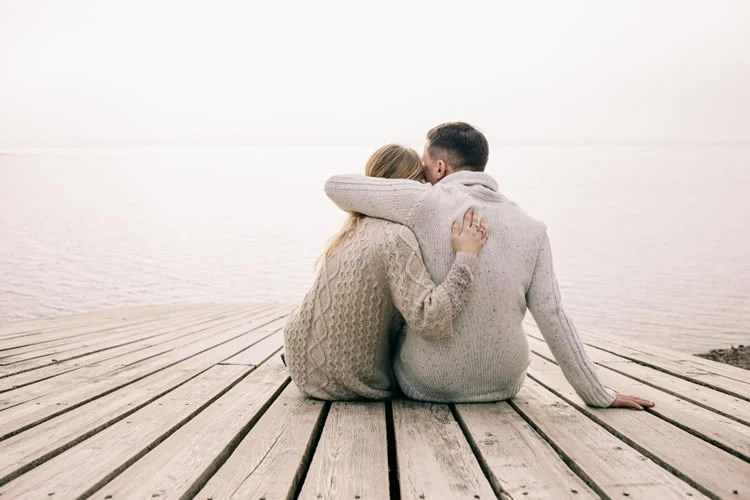 Image shows a man and woman hugging.