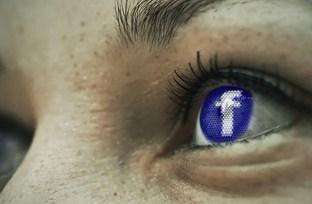 facebook logo in woman's eye