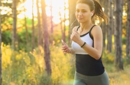 a woman running with headphones on