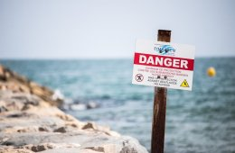 a danger sign on a beach