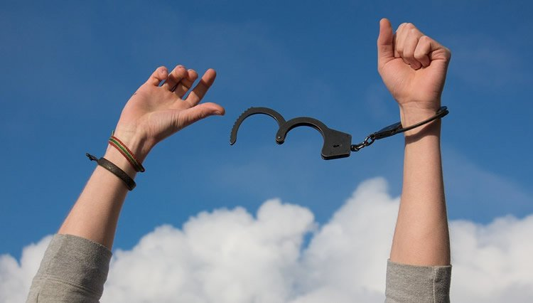 a person breaking free of handcuffs