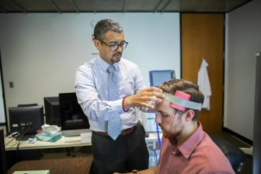 the researcher carrying out tDCS